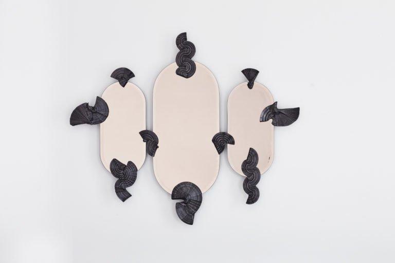 Miroir mural sculptural.