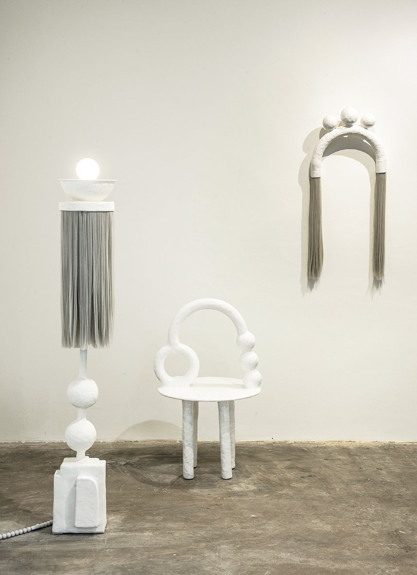 An organic white design furniture collection designed by Brazilian artist Camilla D'Anunziata.