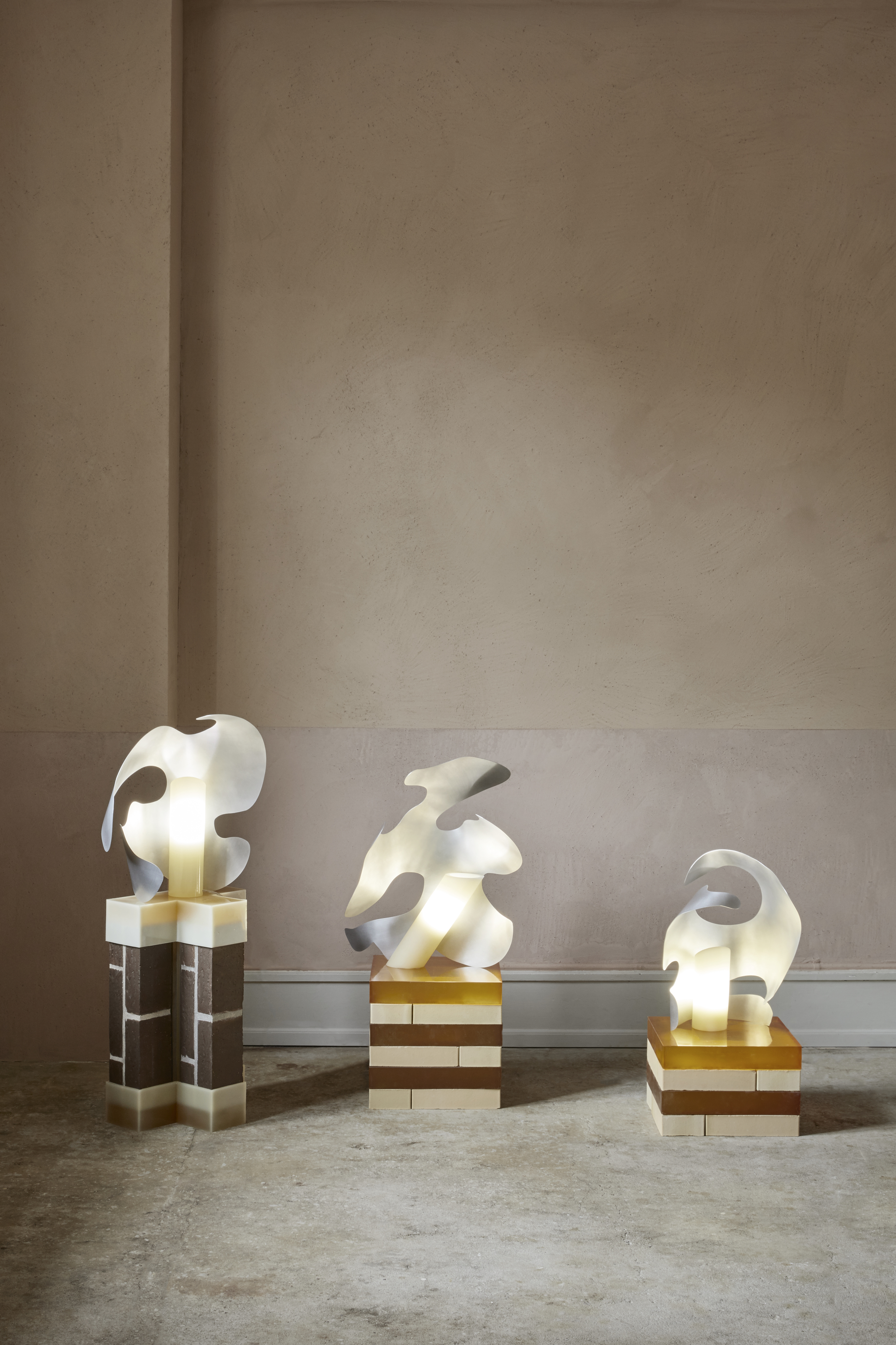 Metal sculptural lamps by Iza Elke